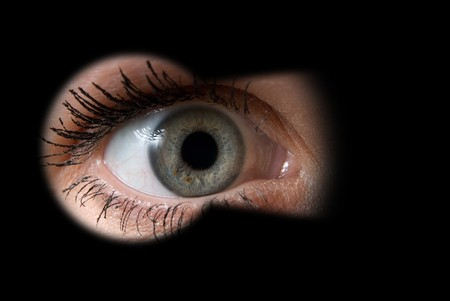 Look through a keyhole. close-up. Stock Photo - 4297859
