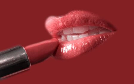 Sensual pretty woman applying cosmetics on her lips close-up shot on purple Stock Photo - 4297858