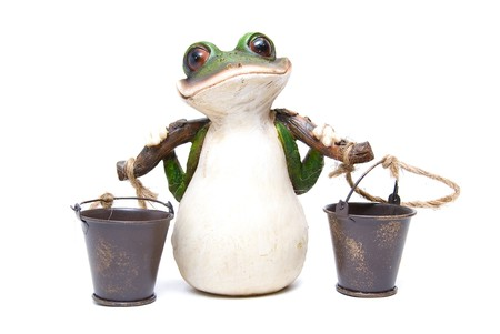 Statuette of frog with buckets on white photo