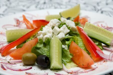 Close-up of Appetizing salad  in a plate on white background. Stock Photo - 4377548