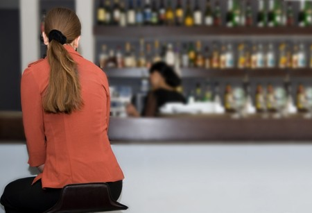 Young woman at the bar counter Stock Photo - 4377537