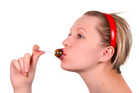 Beautiful girl sucking lollipop on white Stock Photo - 4479525