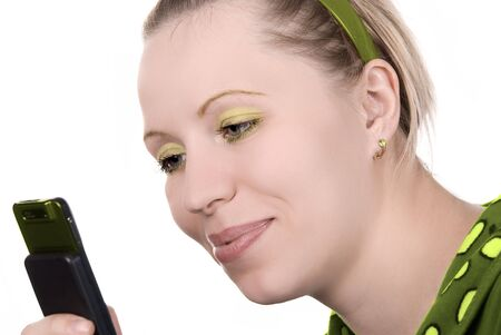 Girl in green with mobile phone on white Stock Photo - 4496360