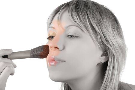 Girl with brush painting her face on white Stock Photo - 4555988