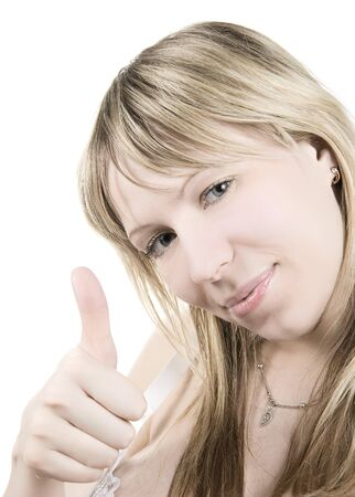 Girl smiling with her thumbs up  isolated on white photo
