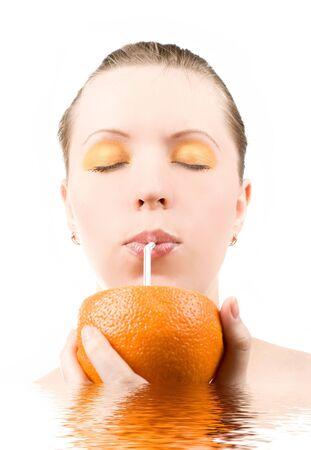 Pretty girl drink orange juice on white Stock Photo - 4579880