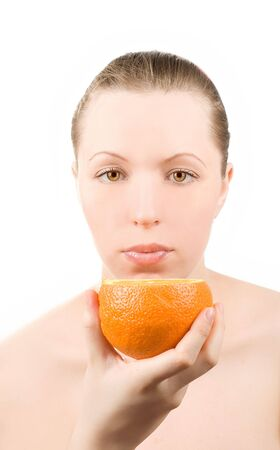 Pretty girl with orange fruit on white Stock Photo - 4579879