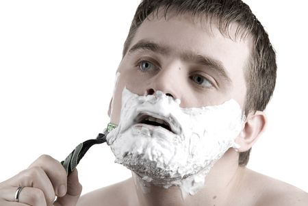Man shaving razor with foam on white photo
