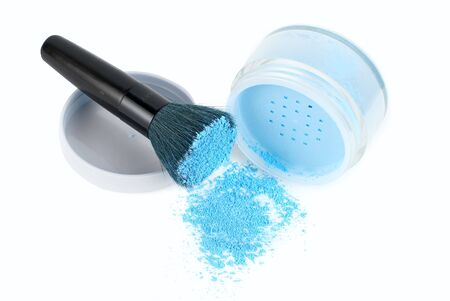 Blue powder and black brush isolated photo