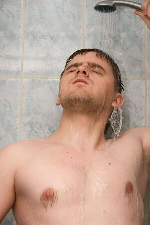Man having shower in bathroom Stock Photo - 4843649