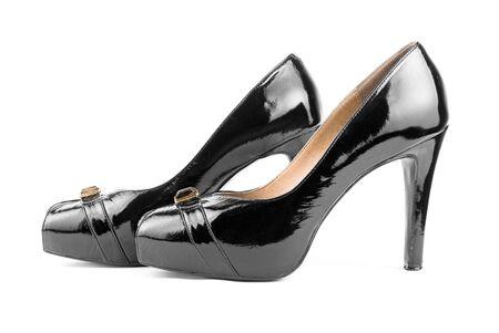 Elegant black high heels shoes isolated on white background photo