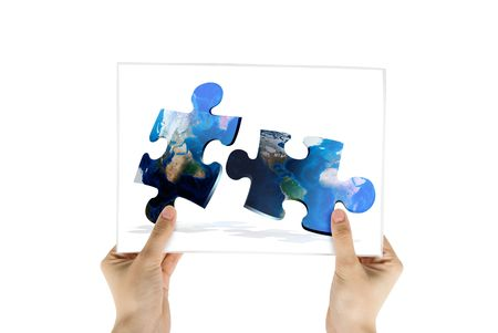 Hand hold photo of global map puzzles communication on white background photo