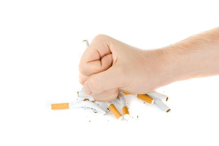 no smoking sign: male fist with many cigarettes isolated on white