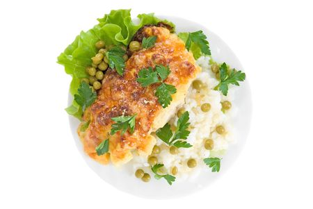 flavorful: Chicken baked with pineapple and cheese very tasty dish with rice vegetables garnish Stock Photo