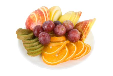 Colorful fruit salad with orange, kiwi, grapes and apple   photo