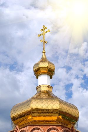 Gold copola. Christianity: �atholicity or orthodoxy church, Cross on sky background photo