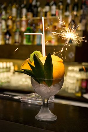 Coctail with sparks at the bar counter photo