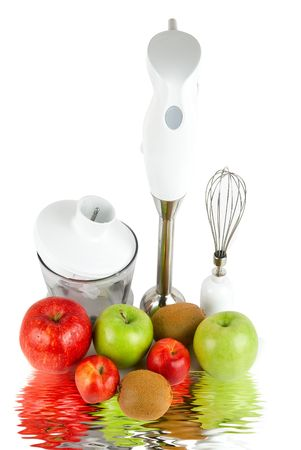 Ripe fruits and blender with reflection on white background photo