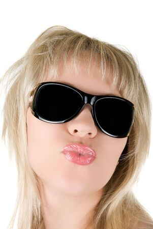 Beautiful, young blond  woman sending kisses isolated on white photo