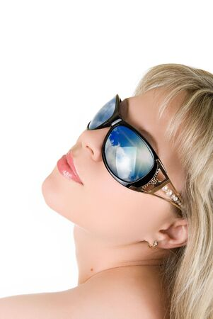 Reflection of blue sky at in girl's sunglasses isolated on white Stock Photo - 5087551