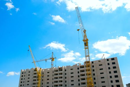 Building crane and building under construction on blue cloudy sky Stock Photo - 5125993