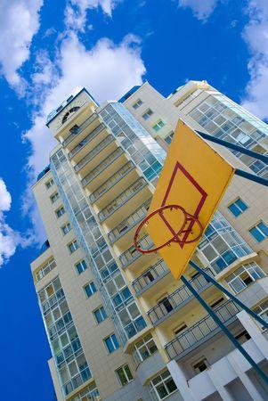 basketball backboard and modern house on blue sky background   photo
