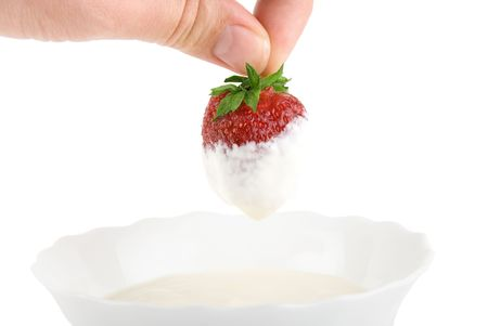 Hand dip strawberry in cream on white Stock Photo - 5131002