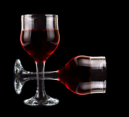 Two wine glasses isolated on black photo