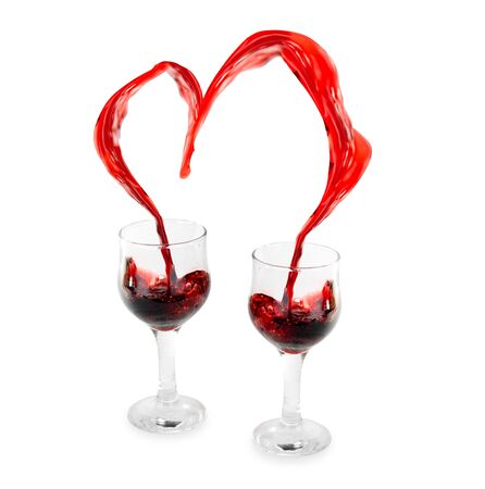 Heart from pouring red wine in goblet isolated on white Stock Photo - 5148843