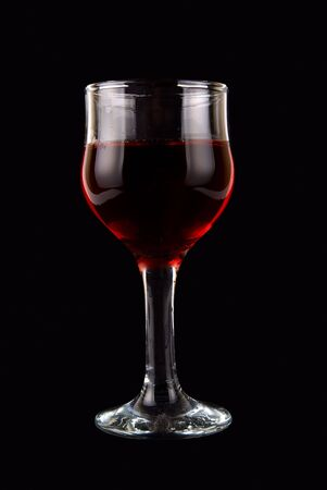 red wine on black background photo