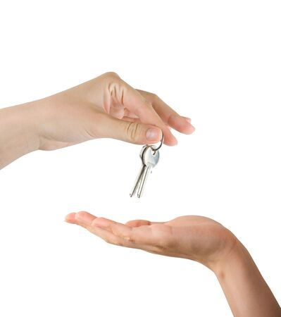 Human hands and key isolated on white background photo