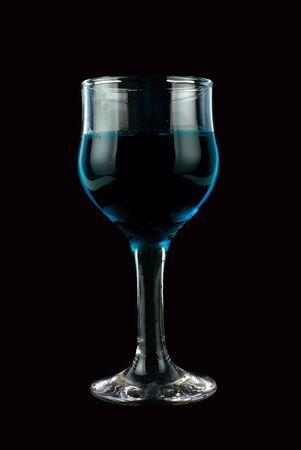 Blue wine on isolated black background photo