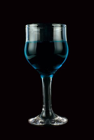 Blue wine on isolated black background photo