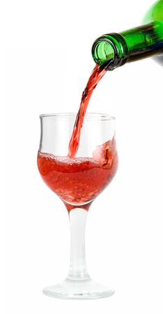 pour red wine into glass isolated on white Stock Photo - 5199113