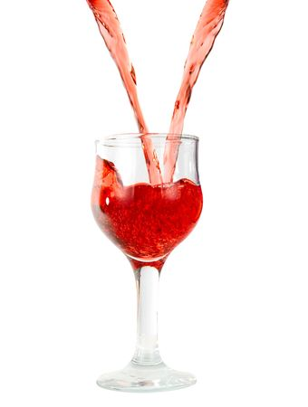 pouring red wine in goblets isolated on white photo