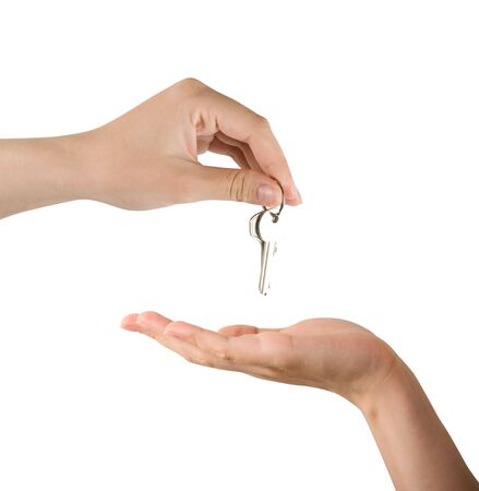 Human hands and key isolated on white background Stock Photo - 5275058