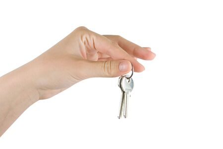 Human hand and key isolated on white background photo