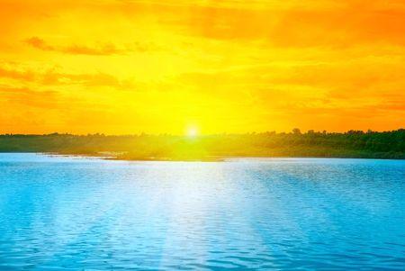 Beauty Sunset on Lake, and orange sky photo
