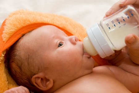 Mother give drink her baby boy by feeding bottle Stock Photo - 5345451