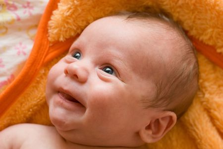 Portrait of laughing baby boy lying on the bed Stock Photo - 5363921