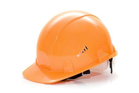 orange helmet isolated on white background photo