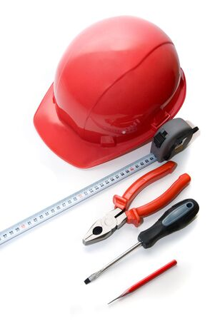 Safety helmet, measuring tape and other tools isolated on white  photo