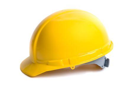 trabajando duro: Casco amarillo aislados sobre fondo blanco