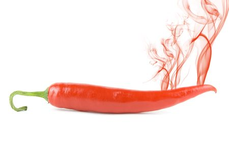 red hot chili pepper with smoke isolated on white photo