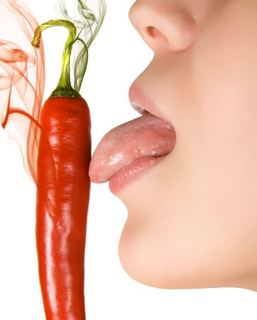 girl close up licking chili pepper  isolated on white photo