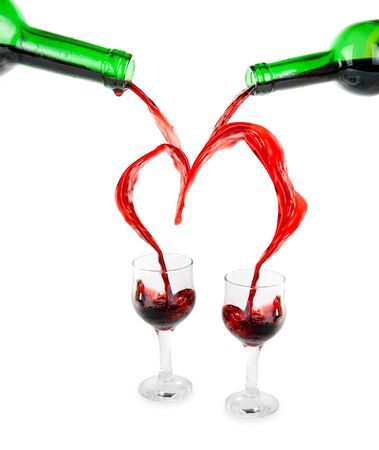 Heart from pouring red wine in goblet isolated on white Stock Photo - 5545685