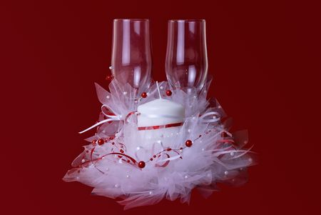 Wedding theme of candle and glasses on red background Stock Photo - 5576851