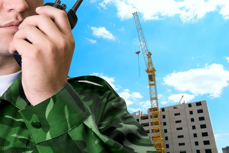transmitter at guard hands closeup on building background Stock Photo - 5616011