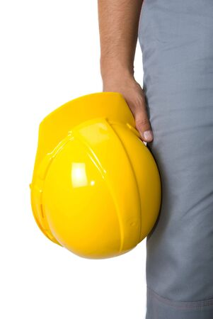 Yellow helmet at man hands isolated on a white photo