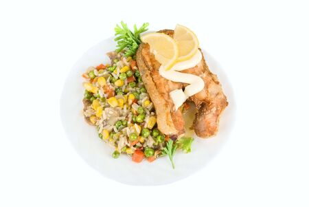Red fish rice and vegetable dish isolated on white photo